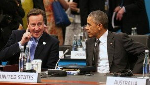 British Prime Minister David Cameron gestures as he talks with US President Barack Obama during a plenary session at the G-20 summit in Brisbane, Australia, Nov. 15, 2014 (photo credit: AP/Rob Griffith,Pool)