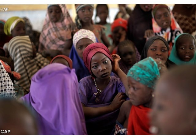 Nigerian girls who fled Boko Haram militants receive help at a refugee camp in neighboring Chad - AP