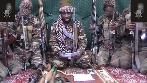 Boko Haram leader Abubakar Shekau (center) in one of the group's propaganda videos.